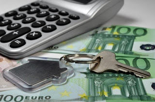 17321891 - calculator, money and house key, shallow depth of field