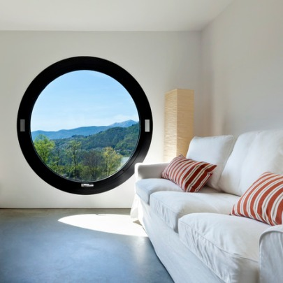 36890860 - beautiful modern house in cement ,room with large porthole
